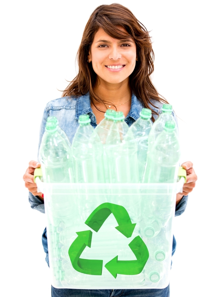 Woman recycling plastic bottles in a bin - isolated over white-1